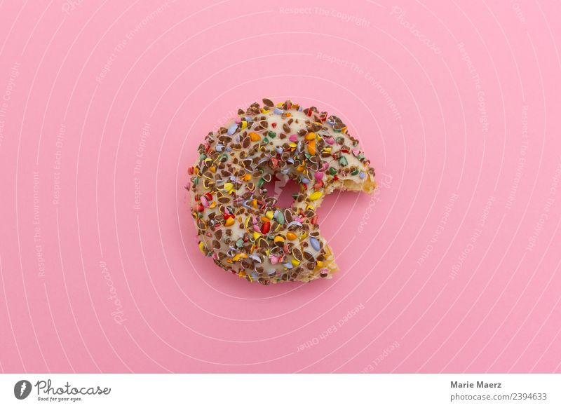 Delicious donut - bitten on Food Dough Baked goods Cake Dessert Nutrition Eating Authentic Brash Fresh Hip & trendy Beautiful Sweet Multicoloured Pink Appetite