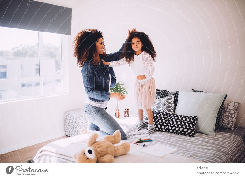 mother and daugther having fun jumping on bed Woman Child Beautiful Joy Lifestyle Adults Love Family & Relations Happy Small Together Jump Smiling Infancy