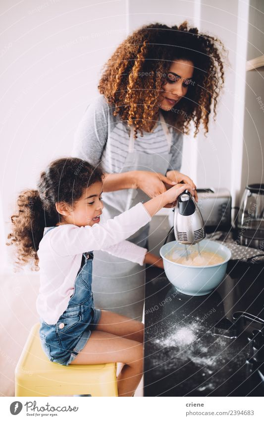 mother and daugther baking cake in the kitchen together Dessert Bowl Lifestyle Joy Happy Kitchen Child School Woman Adults Mother Family & Relations Together