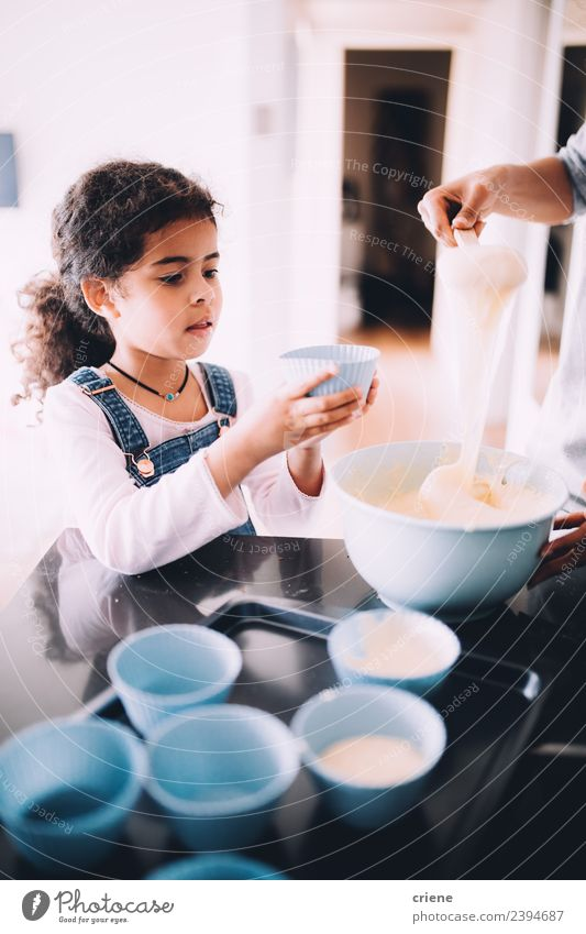 little african girl making cupcakes in kitchen Dessert Bowl Lifestyle Happy Kitchen Child School Woman Adults Small cooking Baking people young Stir food Flour