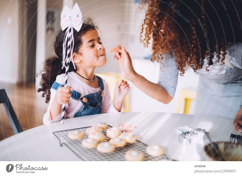 african mother and daughter enjoying their selfmade cookies Dessert Joy Happy Beautiful Kitchen Child Human being Woman Adults Mother Infancy Fingers Happiness