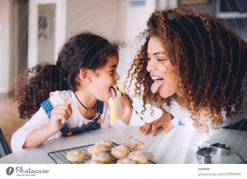 mother and daughter having fun eating cookies together Woman Child Joy Eating Adults Love Funny Family & Relations Happy Smiling Infancy Happiness Cute