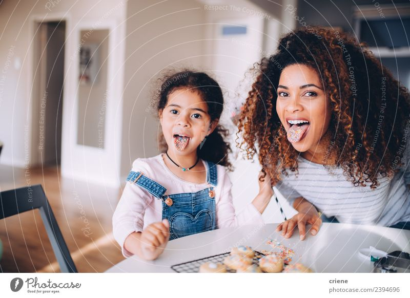 Mother and daughter pulling funny face in kitchen Woman Child Joy Eating Adults Love Funny Family & Relations Happy Infancy Smiling Happiness Cute Kitchen