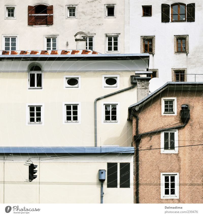 Built-in Austria House (Residential Structure) Facade Window Roof Eaves Old Bright Gloomy Glazed facade Traffic light Narrow Colour photo Exterior shot Pattern