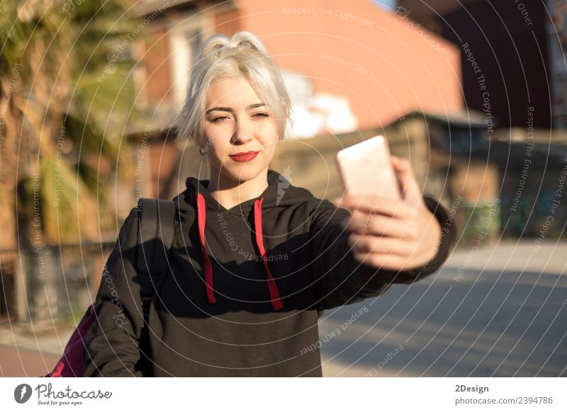 Young woman is taking selfie after school. Lifestyle Style Joy Happy Relaxation Mountain School Schoolyard Schoolchild Student Telephone Cellphone PDA Camera