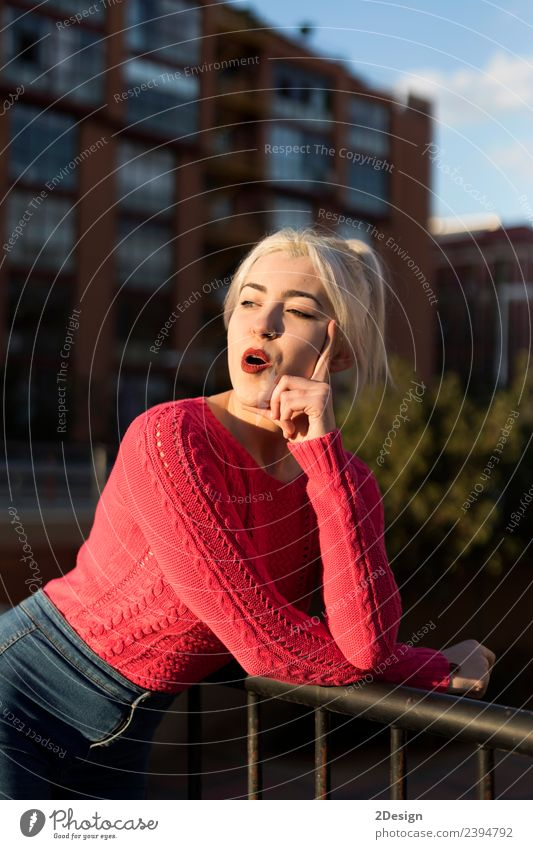 Portrait of a young blonde woman gesturing Woman Human being Youth (Young adults) Young woman Colour Beautiful Red Face Street Adults Environment Meadow Natural