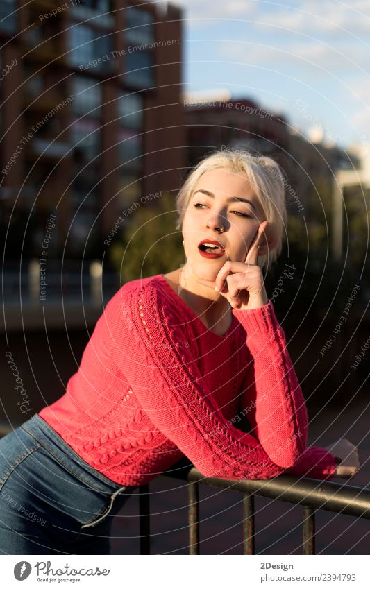 Portrait of a young blonde woman gesturing Woman Human being Youth (Young adults) Young woman Colour Beautiful Red Face Street Adults Lifestyle Environment