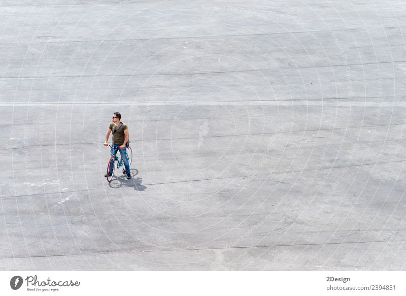 Young man standing with his bike on a square Human being Vacation & Travel Youth (Young adults) Man Street Adults Lifestyle Tourism Copy Space Above Masculine