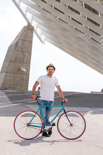 Young Man Biking in a Summer Day on the city Lifestyle Style Joy Relaxation Leisure and hobbies Vacation & Travel Tourism Sports Cycling Human being Masculine