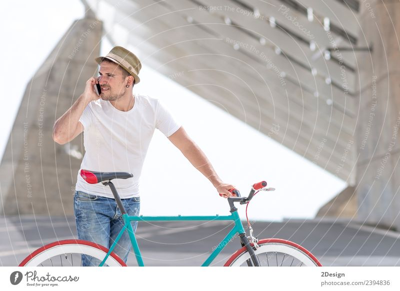 Young handsome guy with a bicycle Lifestyle Style Joy Beautiful Vacation & Travel Adventure Profession Business Telephone Technology Human being Masculine
