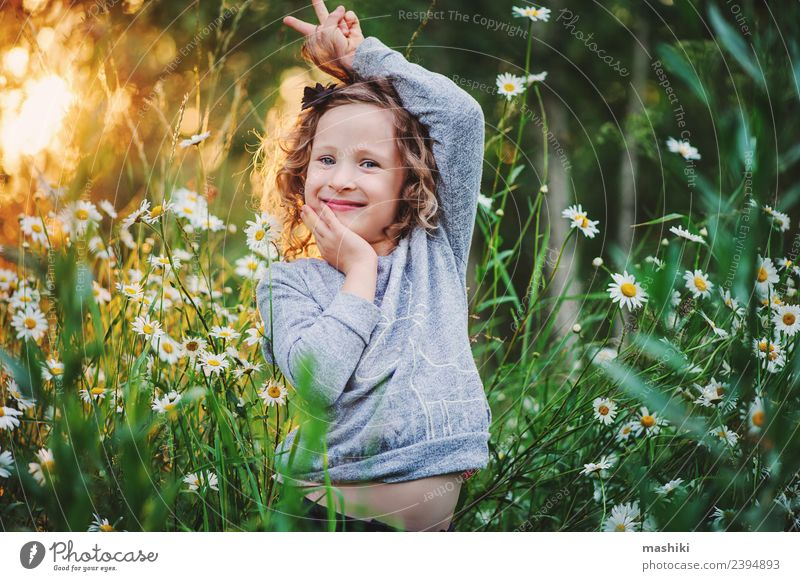 happy kid girl fooling in summer Joy Happy Beautiful Face Playing Vacation & Travel Summer Sun Child Woman Adults Infancy Nature Weather Warmth Flower Grass