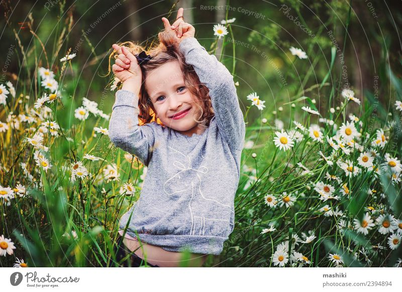 happy kid girl having fun Joy Beautiful Face Playing Vacation & Travel Summer Sun Child Woman Adults Infancy Nature Weather Warmth Flower Grass Forest Smiling