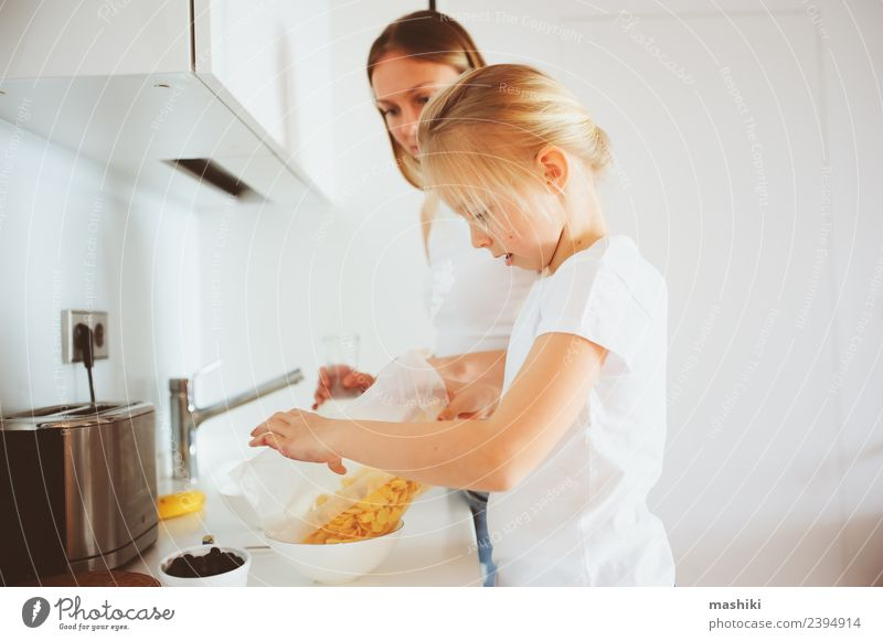 mother having breakfast with kid daughter at home Breakfast Lifestyle Joy Happy Kitchen Child Mother Adults Family & Relations Smiling Embrace Together Modern