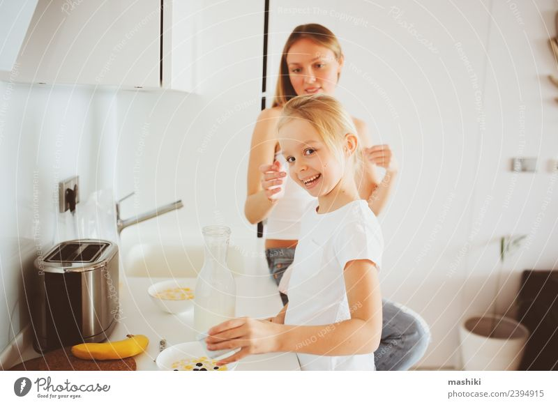 mother having breakfast with daughter Child White Joy Adults Lifestyle Family & Relations Happy Together Modern Smiling Kitchen Mother Breakfast Relationship