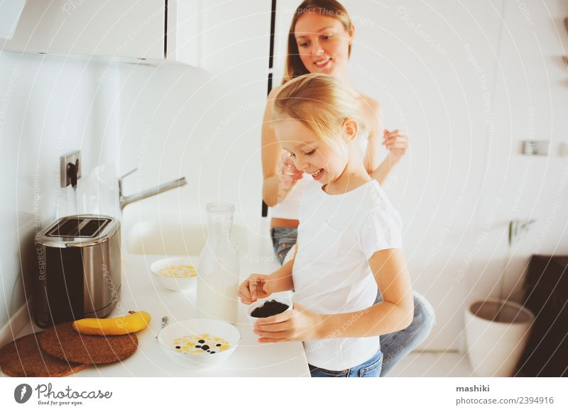mother having breakfast with kid daughter Breakfast Lifestyle Joy Happy Kitchen Child Mother Adults Family & Relations Smiling Embrace Together Modern White