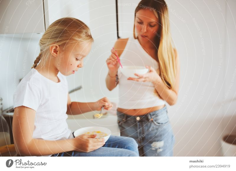 mother having breakfast with daughter Breakfast Lifestyle Joy Happy Kitchen Child Mother Adults Family & Relations Smiling Embrace Together Modern White