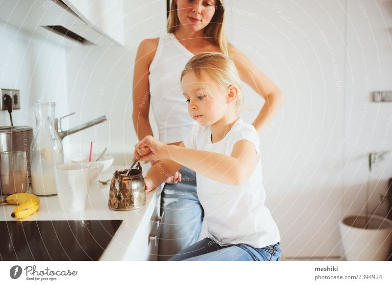 mother having breakfast with kid Breakfast Lifestyle Joy Happy Kitchen Child Mother Adults Family & Relations Smiling Embrace Together Modern White Relationship