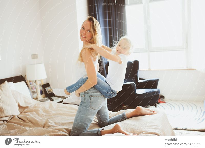 happy family playing at home Lifestyle Joy Relaxation Playing Bedroom Toddler Parents Adults Mother Family & Relations Smiling Sleep Together Small Funny Modern