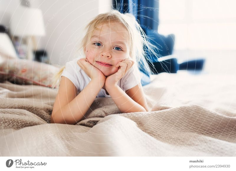 cute happy toddler girl on bed Lifestyle Joy Happy Relaxation Playing Bedroom Toddler Family & Relations Smiling Sleep Small Funny Modern Home Daughter interior