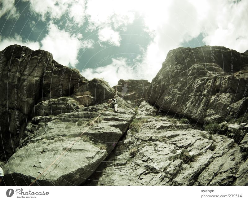 Human being Sports Mountain Rock Leisure and hobbies Tall Alps Climbing Upward Mountaineering Cervice Clouds in the sky Wall of rock Climbing rope