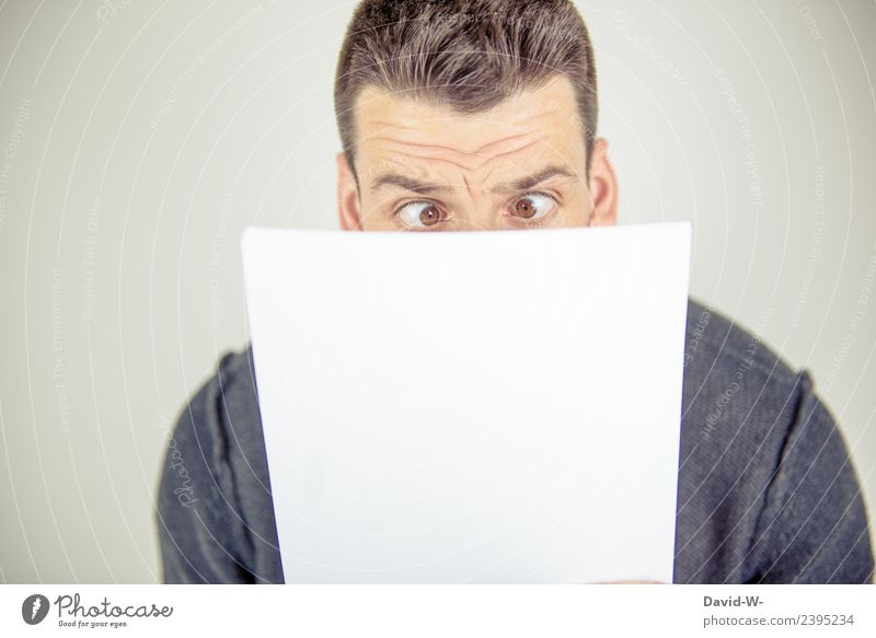Man looks at sheet of paper and squints in shock Lifestyle Education Adult Education School Study schuler Professional training Academic studies
