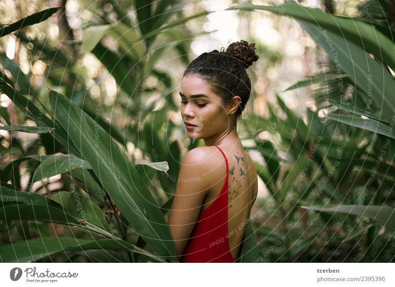 Beautiful brazilian woman with tattooed back among green leaves Human being Youth (Young adults) Young woman Summer Plant Green Red Leaf Calm 18 - 30 years