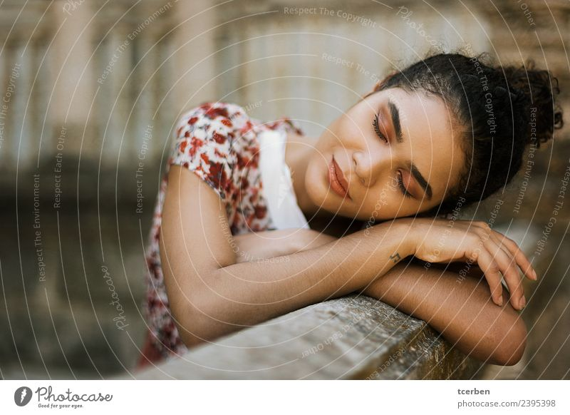 Close up portrait of sweet brazilian woman leaning against wall Feminine Young woman Youth (Young adults) 1 Human being 18 - 30 years Adults Town Wall (barrier)