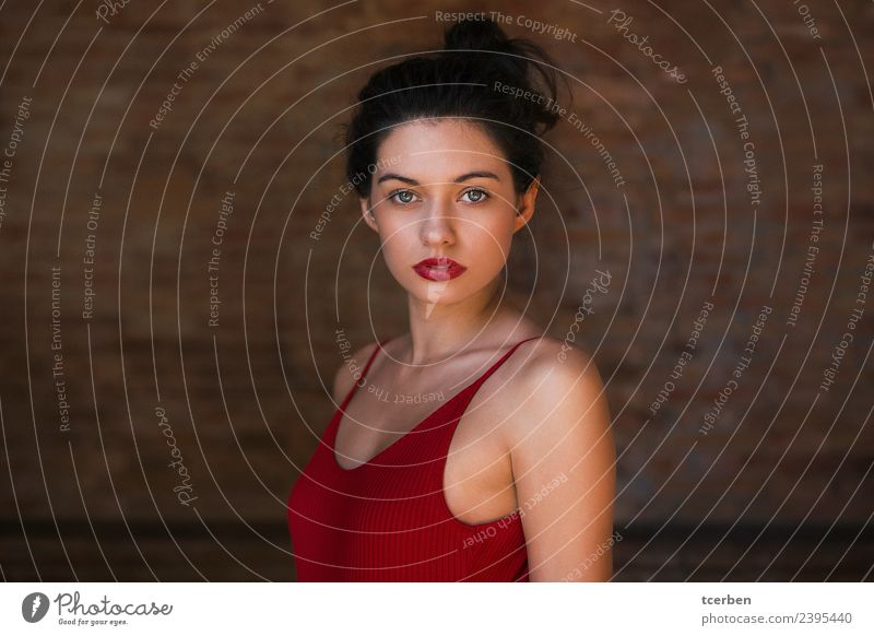 Close up portrait of pretty brunette woman with red shirt Feminine Young woman Youth (Young adults) Eyes 1 Human being 18 - 30 years Adults Wall (barrier)