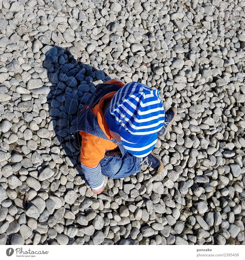Human being Nature Summer Playing Stone Infancy Beautiful weather Cute Curiosity Touch Discover Lakeside Elements Many Cap Toddler
