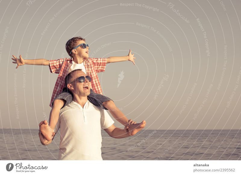 Father and son playing on the beach at the day time. Lifestyle Joy Happy Relaxation Leisure and hobbies Playing Vacation & Travel Trip Adventure Freedom Camping