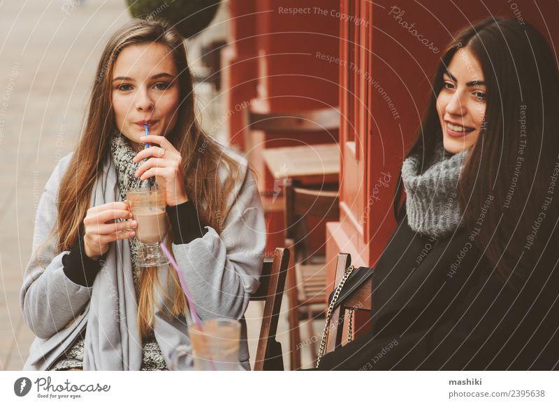 two happy girl friends talking Coffee Lifestyle To talk Feminine Woman Adults Friendship Autumn Street Fashion Coat Smiling Laughter Together Hip & trendy Funny