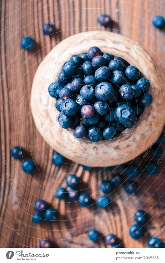 Freshly gathered blueberries put into old ceramic bowl Nature Blue Summer Dish Natural Wood Above Fruit Nutrition Vantage point Authentic Table Delicious