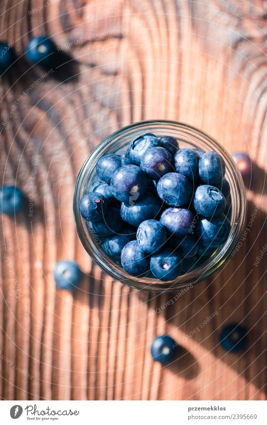Freshly gathered blueberries put into jar Nature Blue Summer Natural Wood Food Above Fruit Nutrition Vantage point Authentic Table Delicious Harvest