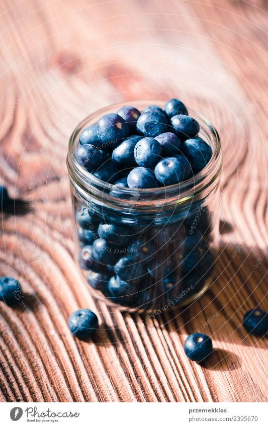 Freshly gathered blueberries put into jar Nature Blue Summer Natural Wood Fruit Nutrition Table Delicious Harvest Mature Berries Bowl Vegetarian diet Vitamin