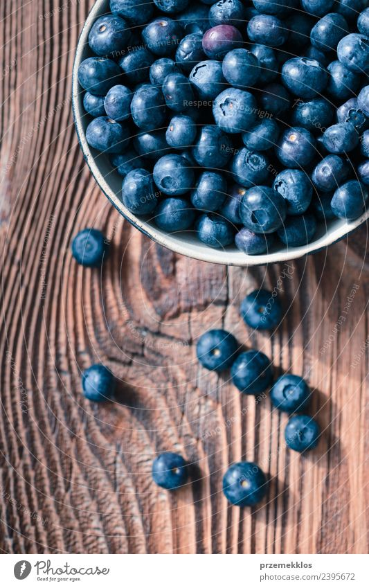 Freshly gathered blueberries put into ceramic bowl Nature Blue Summer Natural Wood Food Above Fruit Nutrition Vantage point Authentic Table Delicious Harvest