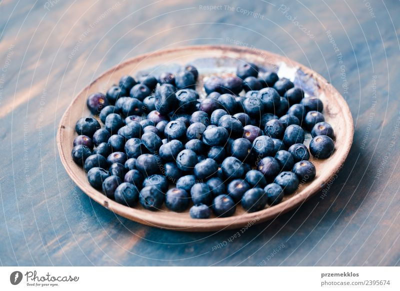 Freshly gathered blueberries put on old ceramic plate Nature Blue Summer Natural Wood Fruit Nutrition Table Delicious Harvest Organic produce Mature Berries