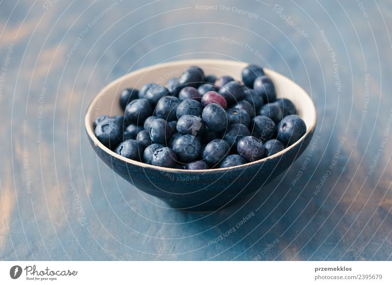 Bowl full of fresh blueberries put on table painted in blue Nature Blue Summer Natural Wood Food Fruit Nutrition Fresh Table Delicious Harvest Mature Berries