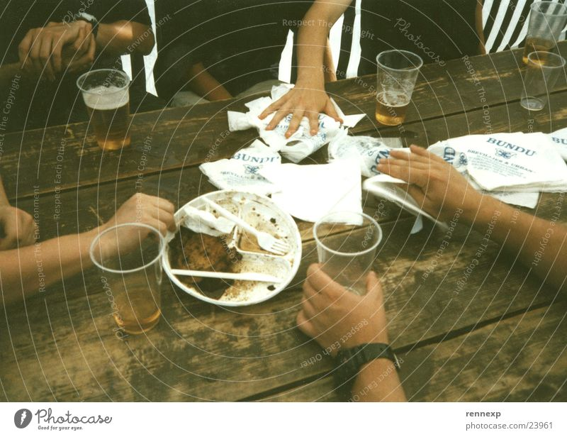 after eating Hand Plate Cutlery Mug Beer Napkin Cleaning Camping Table Grasp Touch Fast food Meat Environmental pollution Paper Spill Wooden table Varnished