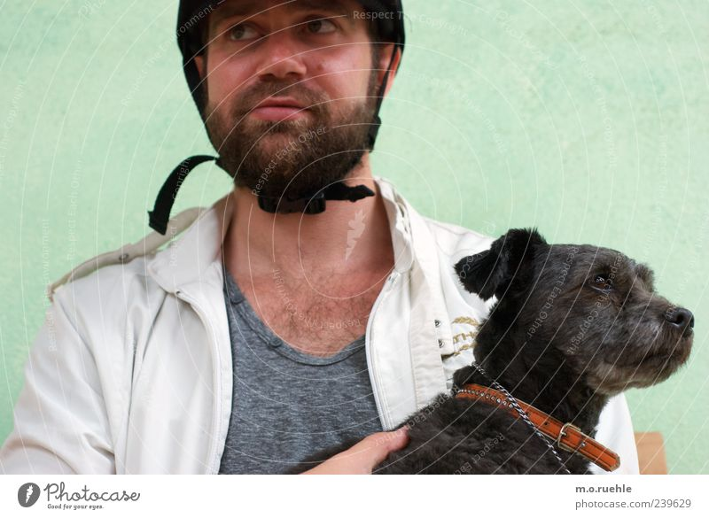 Black sheep Leisure and hobbies Equestrian sports Human being Masculine Skin Head Face Nose Mouth Facial hair 1 Hat Beard Hairy chest Animal Pet Dog