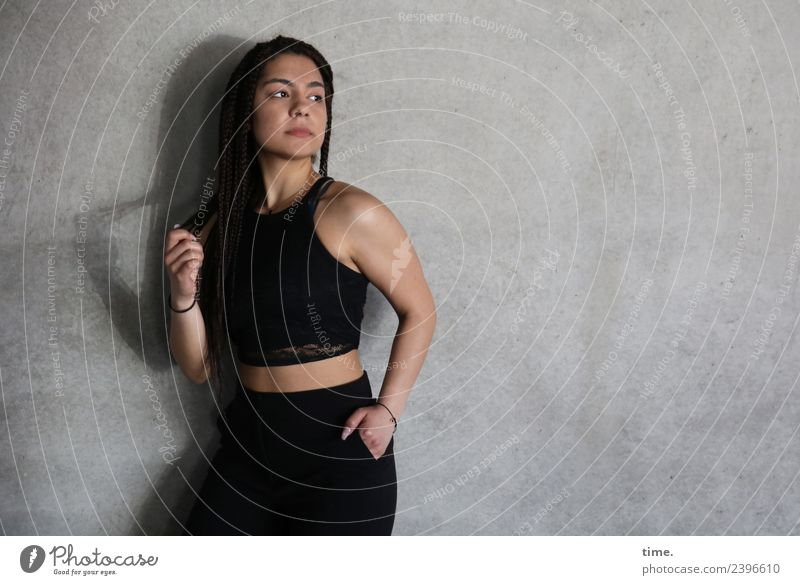 Nikoliya Feminine Woman Adults 1 Human being Wall (barrier) Wall (building) T-shirt Pants Brunette Long-haired Plaited Observe To hold on Looking Stand
