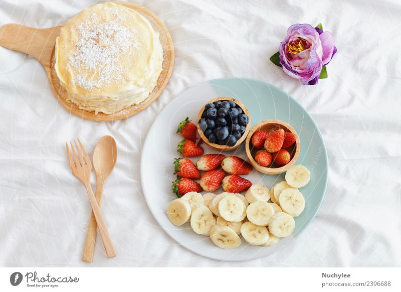 Tasty crape cake with fresh fruit Fruit Dessert Nutrition Eating Breakfast Fork Spoon Lifestyle Summer Flower Wood Fresh Delicious Natural White bed food