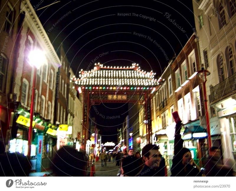 Chinatown London Tourism Store premises Restaurant Main street Pedestrian precinct Archway Passage Canopy Roof Chinese Going out Lamp Electric bulb