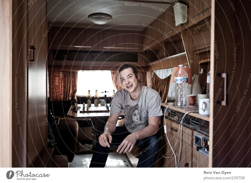 Camper guy Man Youth (Young adults) Window Happy Laughter Contentment Brown Adults Masculine Happiness Jeans T-shirt Joie de vivre (Vitality) Friendliness