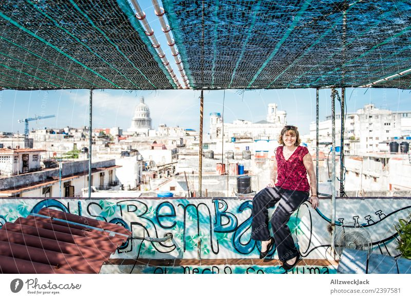 Vacation & Travel Young woman Summer Travel photography Vantage point Sit To enjoy Concrete Construction site Skyline Posture Apartment Building Cloudless sky