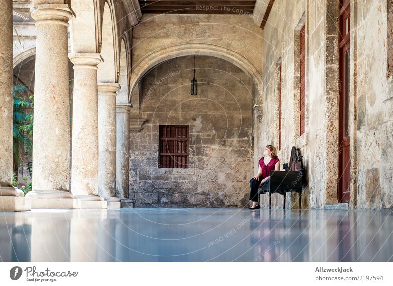 Vacation & Travel Young woman Relaxation Calm Far-off places Travel photography Wall (barrier) Sit To enjoy Break Discover Bench Wanderlust Sightseeing Cuba