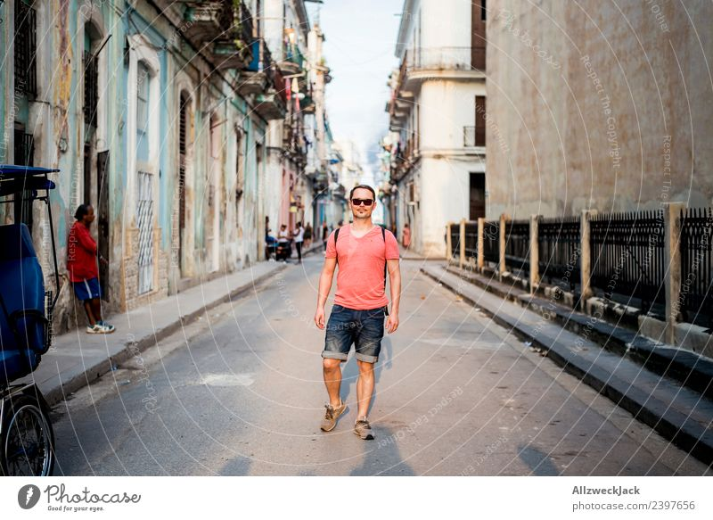 Man walking in the streets of Havana Cuba Island Socialism Vacation & Travel Travel photography Trip Sightseeing Sunset Street Alley Town Blue sky Clouds
