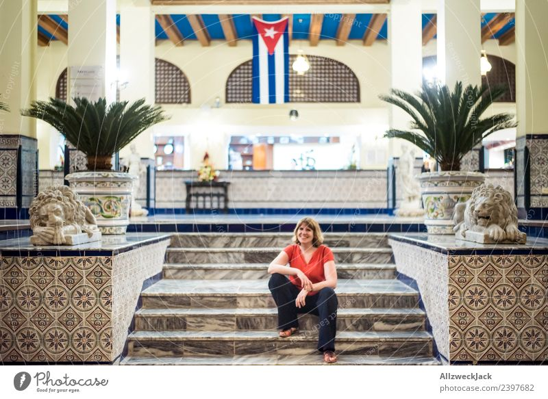 young woman sitting in front of hotel in Havana Cuba Island Socialism Vacation & Travel Travel photography Trip Sightseeing Hotel Flag Patriotism Wanderlust