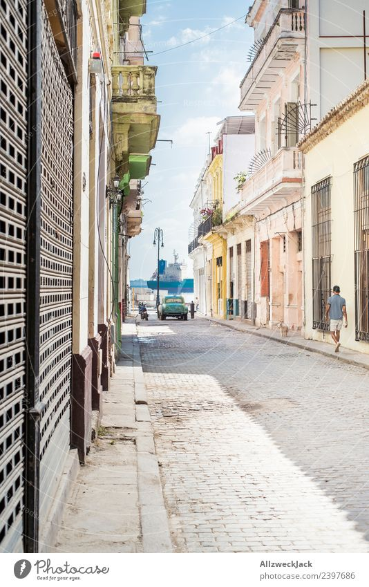 pretty colorful alleyway in Havana with view to the harbour Cuba Island Vacation & Travel Travel photography Trip Sightseeing Street Alley Town Blue sky