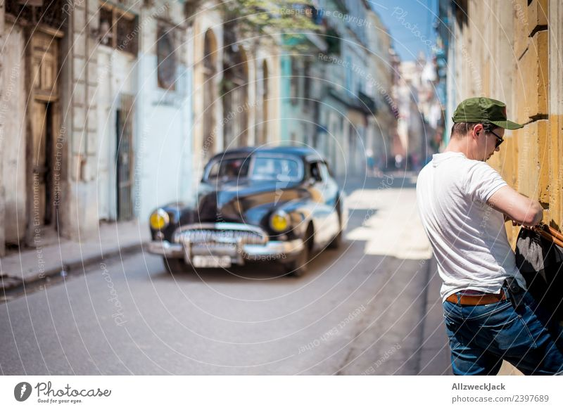 Man and classic car in a street in Havana Cuba Island Vacation & Travel Travel photography Trip Sightseeing Alley Street Town Blue sky Wanderlust Day Sun Summer