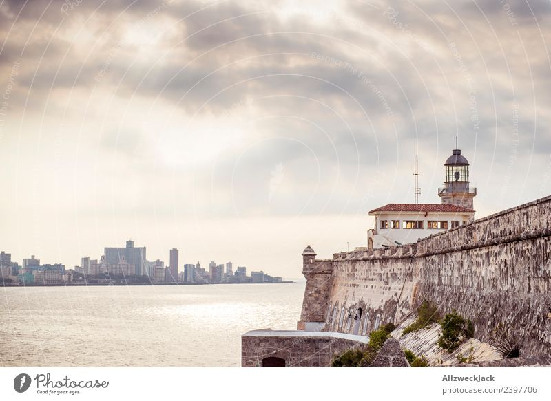 View over the sea to the Malecón of Havana Cuba Island Socialism Vacation & Travel Travel photography Trip Sightseeing Twilight Clouds Covered Lighthouse